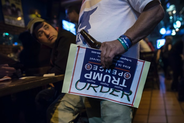 An Israeli Trump supporter watches the election results at a bar in Jerusalem.