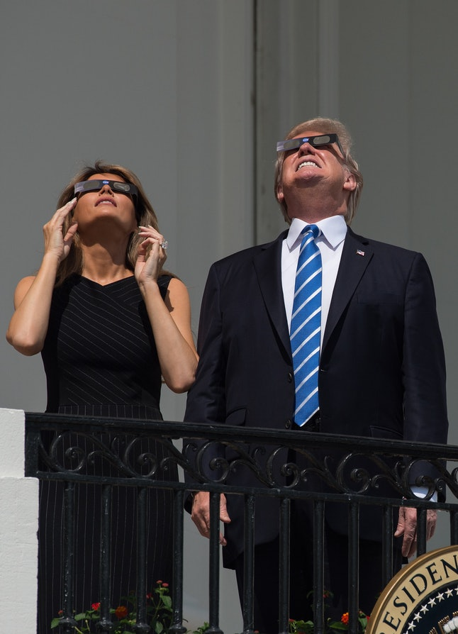 Melania Trump and her husband watching the eclipse