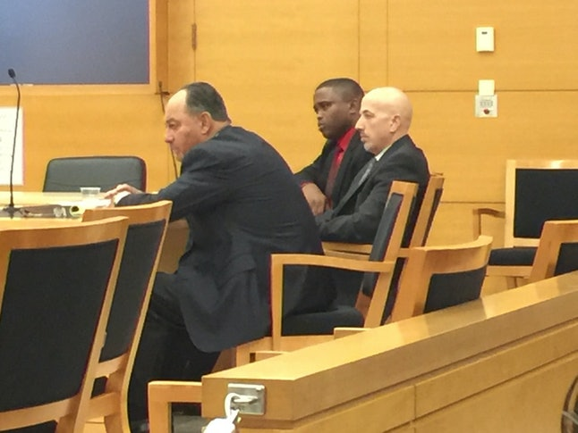 (Center) Wayne Isaacs sits in court with his lead defense attorneys Stephen Worth (left) in Brooklyn, NY on Nov. 2, 2017.