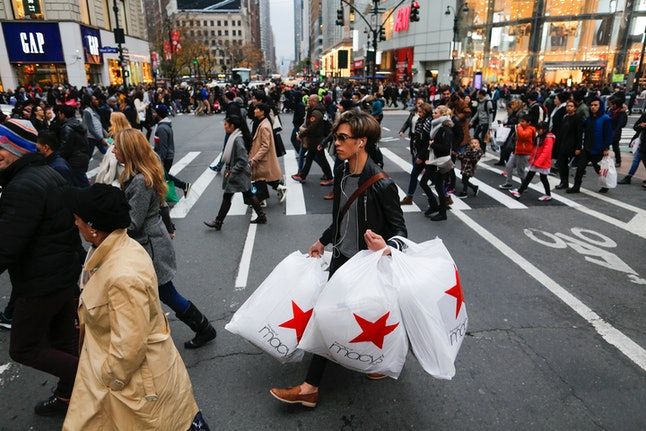 People carry retail shopping bags during Black Friday events  in New York City.