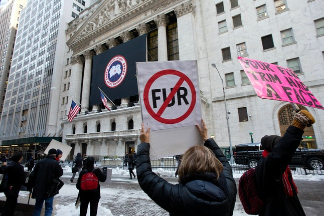 PETA picketing against Canada Goose outside of the New York Stock Exchange.