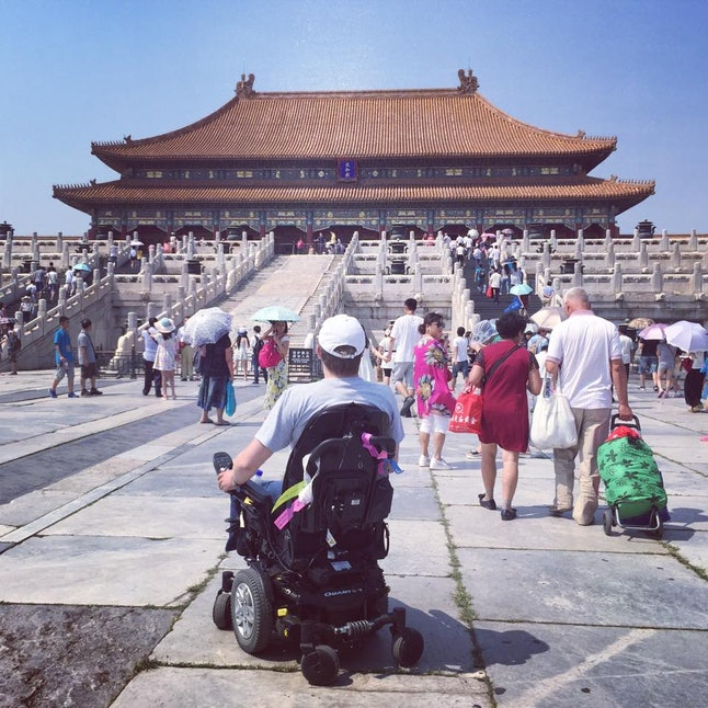 "John Morris inside the Forbidden City. ""While the attraction is not fully accessible, ramps lead to the majority of the primary structures and galleries within. Some ramps are quite steep but are not a danger to powered wheelchairs."""