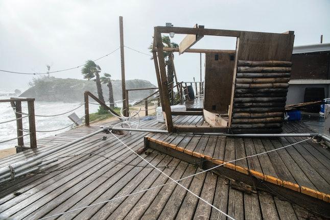 A tiki bar in Bermuda toppled over during Hurricane Nicole.