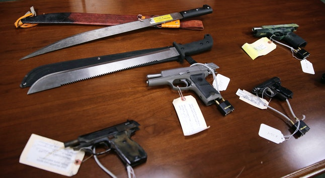 Weapons on display at the U.S. attorney's office following the arrest of 56 MS-13 gang members in Boston. The gang is known for using machetes in its violent attacks.