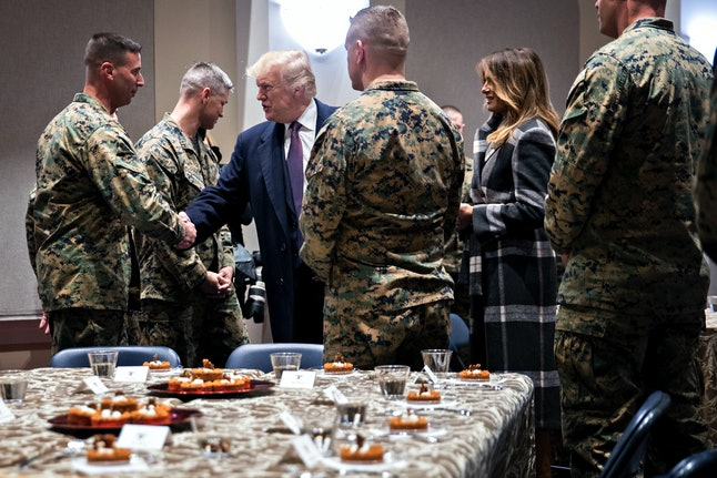 President Donald Trump and first lady Melania Trump greet Marines on Thursday in Washington, D.C.