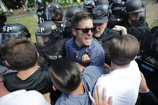 White nationalist Richard Spencer and his supporters clash with Virginia State Police in Emancipation Park after the 'Unite the Right' rally on Aug. 12 in Charlottesville, Virginia.