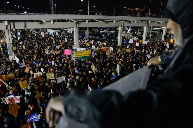 "While lawyers worked on the inside, thousands protested at JFK on Saturday night, chanting ""Let them in!"""