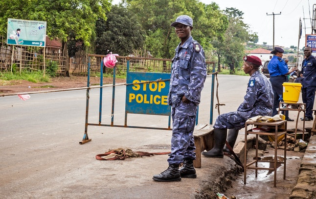 Police guard a roadblock as Sierra Leone government enforces a three day lock down on movement of all people in an attempt to fight the Ebola virus, in Freetown, Sierra Leone, Friday, Sept. 19, 2014.