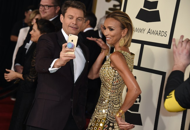 Ryan Seacrest, left, and Giuliana Rancic take a selfie at the 58th annual Grammy Awards at the Staples Center on Feb. 15, 2016, in Los Angeles.