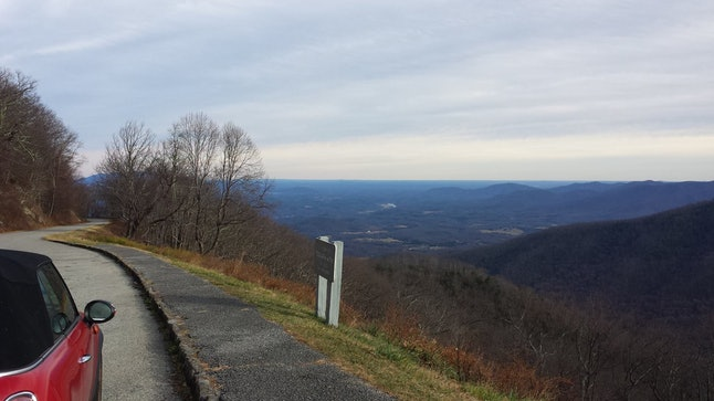 The author taking in the view of the Blue Ridge Mountains in North Carolina.