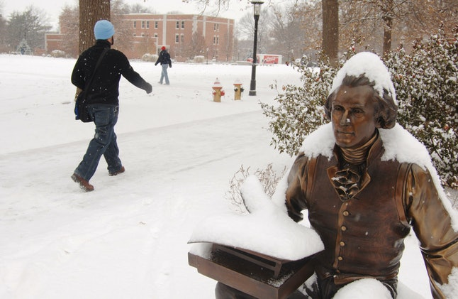 Students walk past a snow covered bronze statue of Thomas Jefferson on their way to class Thursday, Dec. 8, 2005, on the University of Missouri campus in Columbia, Missouri.