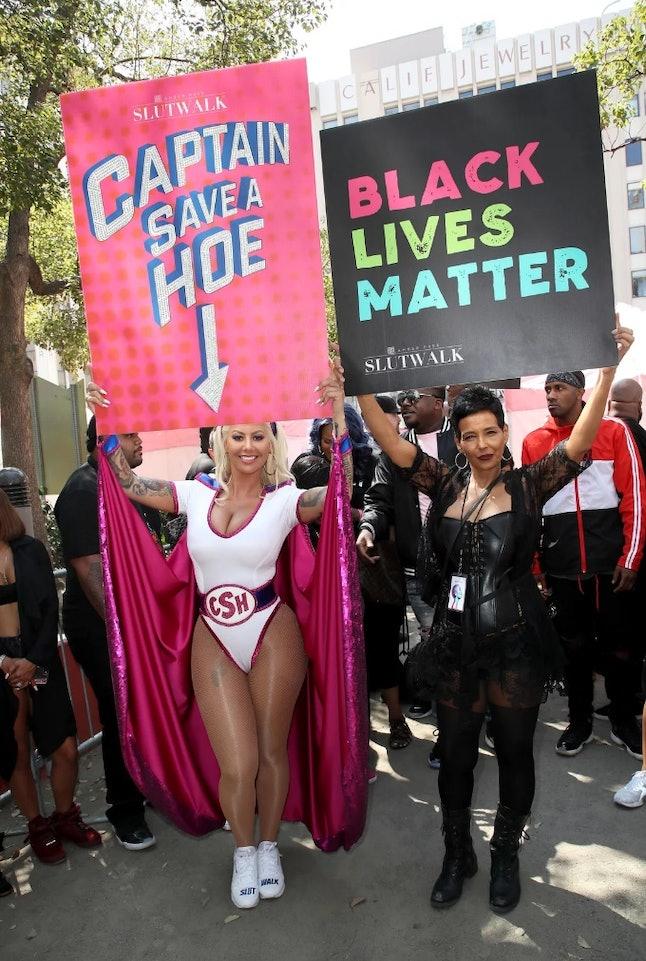 """Amber Rose holding up """"Captain Save-a-Hoe' sign at her SlutWalk in 2017."""
