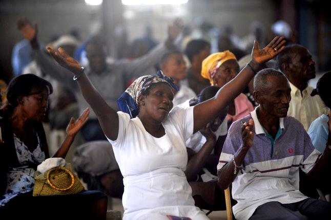 Residents of Port-Au-Prince, Haiti, attend mass in January 2014, marking the anniversary of the 2010 earthquake.