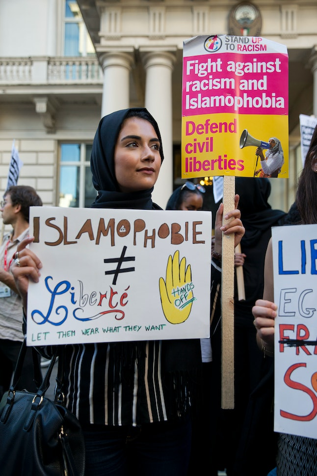 Demonstrators gathered, uniting against the burkini ban, outside the French embassy in London Friday.