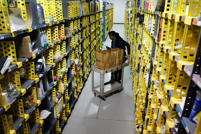 An Amazon employee fills an Amazon Prime Now order in New York.