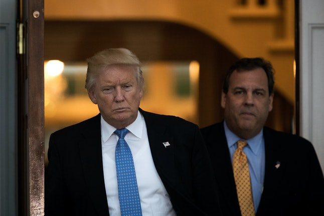 Donald Trump and New Jersey Governor Chris Christie emerge from the clubhouse following their meeting at Trump International Golf Club.