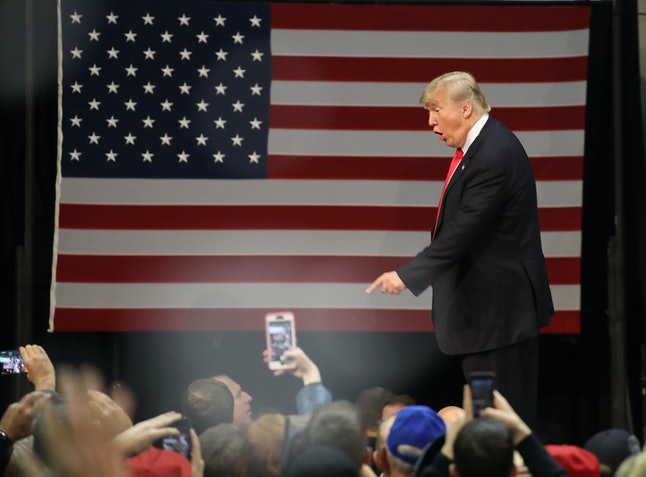 President Donald Trump greets people during a rally in Florida on Friday.