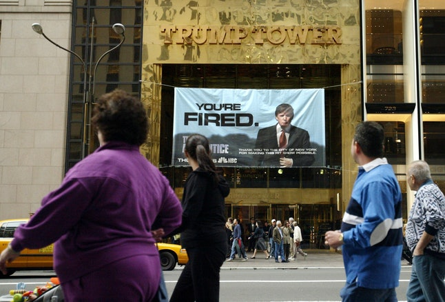 An ad for 'The Apprentice' hangs on Trump Tower in 2004.