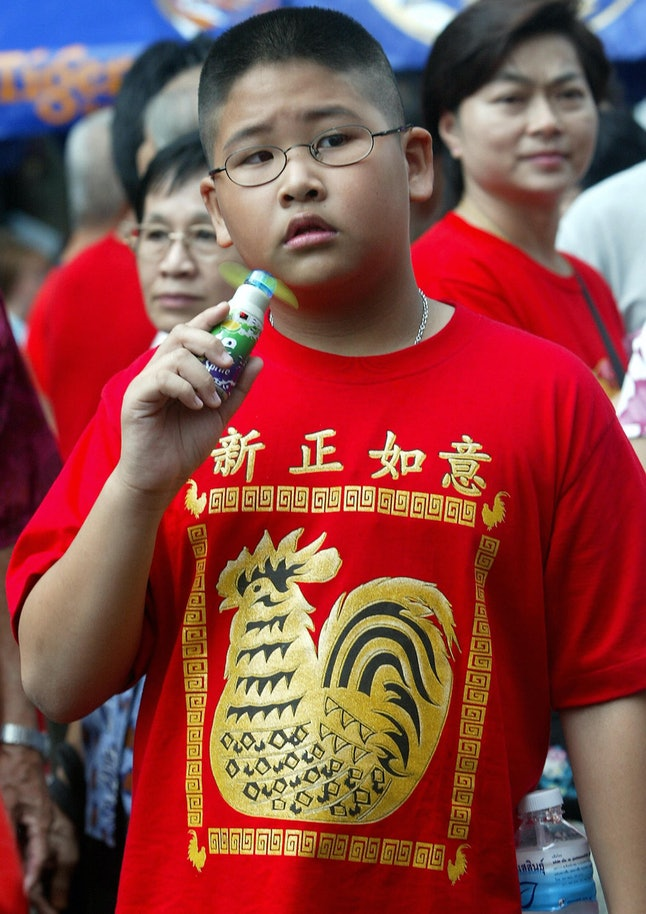 Bangkok, Thailand: a boy wears a shirt welcoming in the year of the Rooster on Feb. 9, 2005.