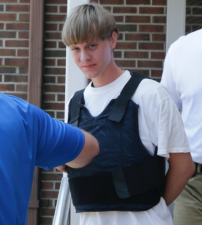 Dylann Roof is escorted out of the Shelby, North Carolina, police station in June 2015.