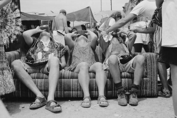 A bunch of hippies in sandals at a Grateful Dead concert in the '80s