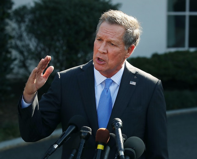 Republican Gov. John Kasich of Ohio speaks to reporters after a closed meeting with Trump.