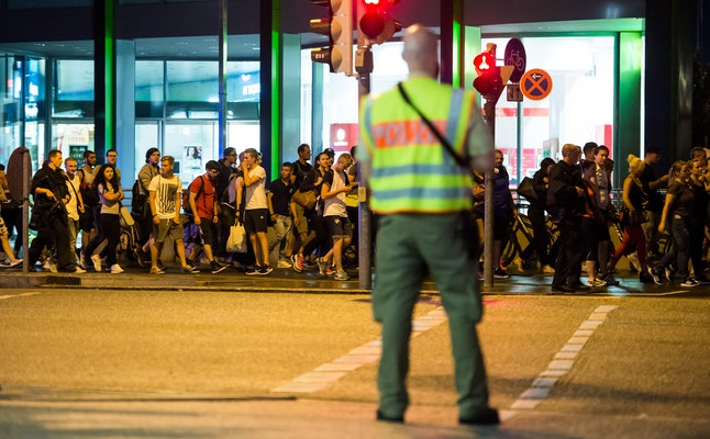 People are evacuated from Olympia-Einkaufszentrum in Munich after a gun-wielding teen fatally shoots nine people on July 22, 2016.