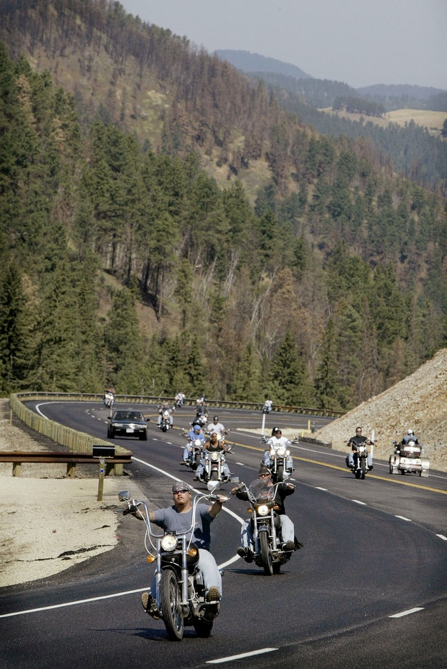 Bikers ride through the Black Hills National Forest on the outskirts of Sturgis, South Dakota, during the annual Sturgis Motorcycle Rally on Aug. 6, 2003.