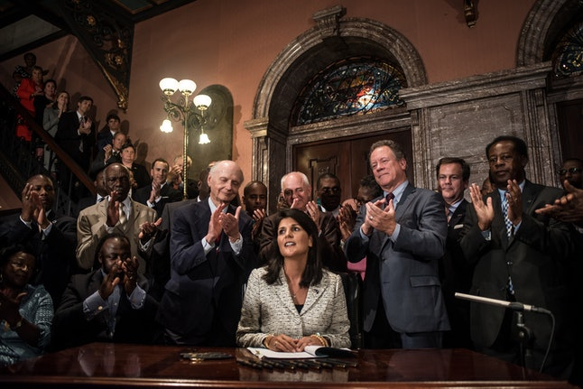 South Carolina Gov. Nikki Haley signs a bill to remove the Confederate flag from the state house.