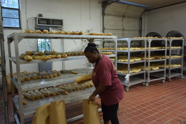 A worker packs up Cuban bread for delivery