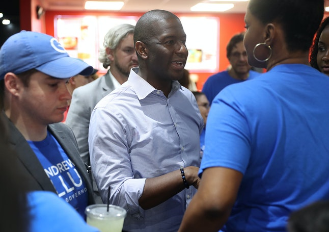 Florida Democratic gubernatorial candidate Andrew Gillum mingles with people in Miramar, Florida, on the last day of early voting Sunday.