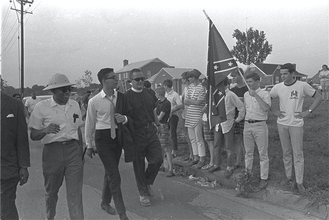 When James Meredith — the first black man to attend the University of Mississippi — graduated, it caused riots. This photo, in which Meredith is taunted with Confederate flags, is from a later march to encourage black voter registration, in which he walked 225 miles from Memphis, Tennessee, to Jackson, Mississippi.