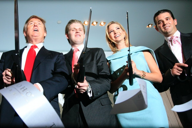 Donald Trump and his children at the opening ceremony for the Trump SoHo hotel in New York City.