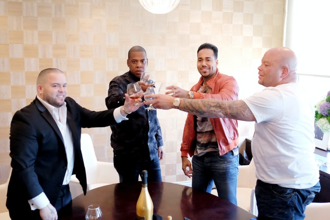 Jay Z with Romeo Santos, who recently signed to Roc Nation