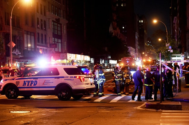 Police and firefighters gather at the site of an explosion that rocked New York City's Chelsea neighborhood Saturday night.