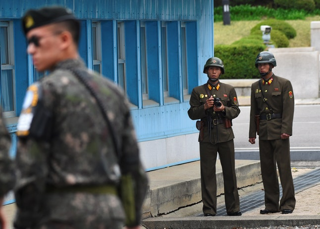 North Korean soldiers look across the nation's southern border with South Korea during Vice President Mike Pence's recent visit the demilitarized zone.