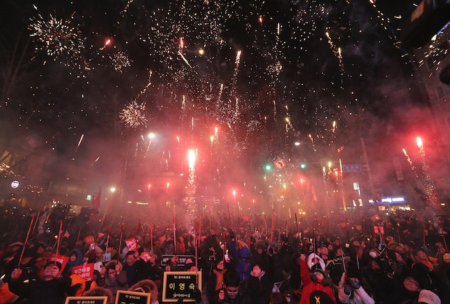Protesters set off fireworks during a rally against impeached South Korean President Park Geun-hye in December.