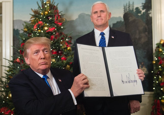 President Donald Trump signs a proclamation after delivering a statement on Jerusalem.