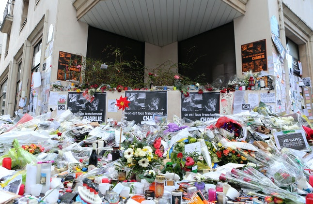 Mourners laid flowers outside the headquarters of Charlie Hedbo magazine in January of 2015 after a terrorist attack there killed 12 people and injured 11 others.