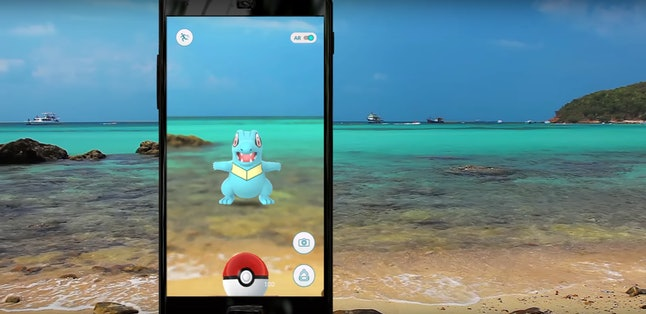 Totodile, a Gen 2 water-type Pokémon, depicted on the beach in the new Pokémon Go trailer.