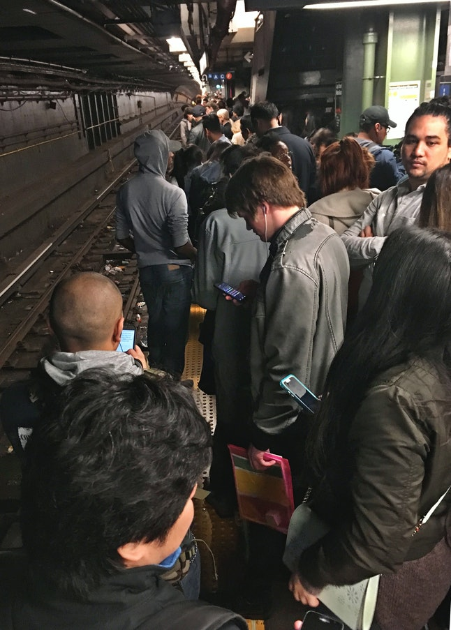 Commuters crowd the subway platform along the R and W train tracks at the Jay Street/Metro Tech station in Brooklyn during a delay in the morning rush hour service, April 21.