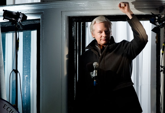 Assange currently resides in the Embassy of Ecuador in London. If he left, he'd be arrested immediately.