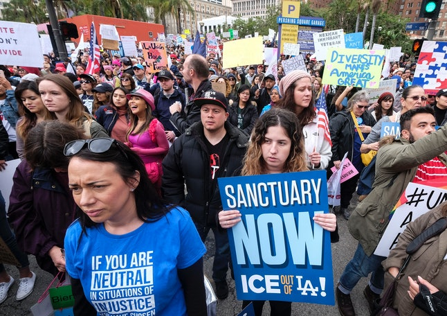 Protesters in Los Angeles rally behind immigrants targeted by President Donald Trump's rhetoric and policies.