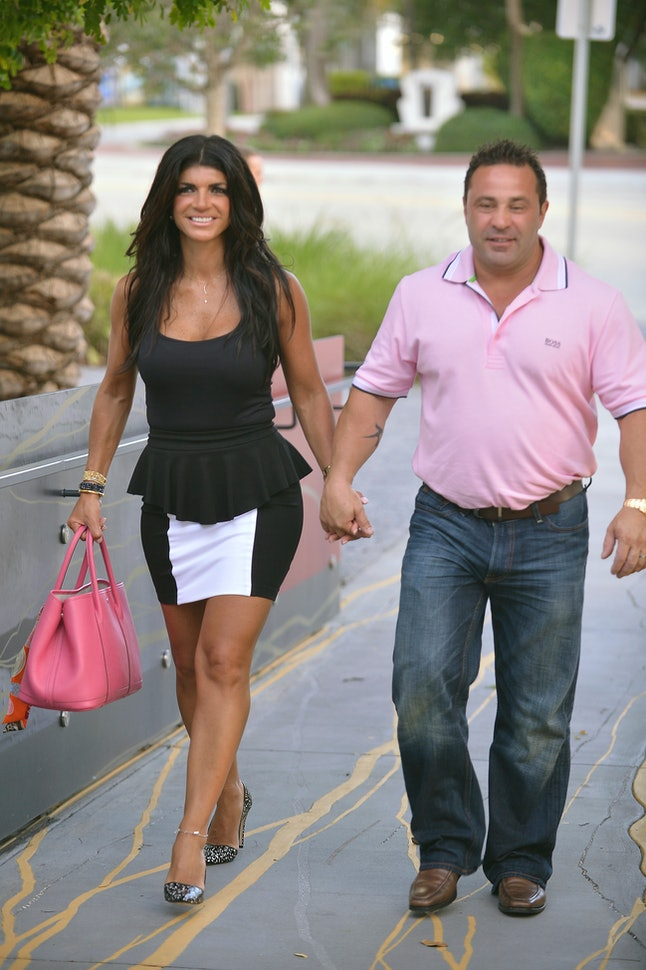 Teresa Giudice and her husband Joe Giudice greet fans on June 21, 2013 in Fort Lauderdale, Florida.
