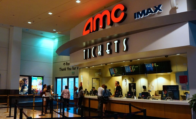 Moviegoers purchase automated tickets at an AMC movie theater in Arcadia, California, on Aug. 2, 2017.
