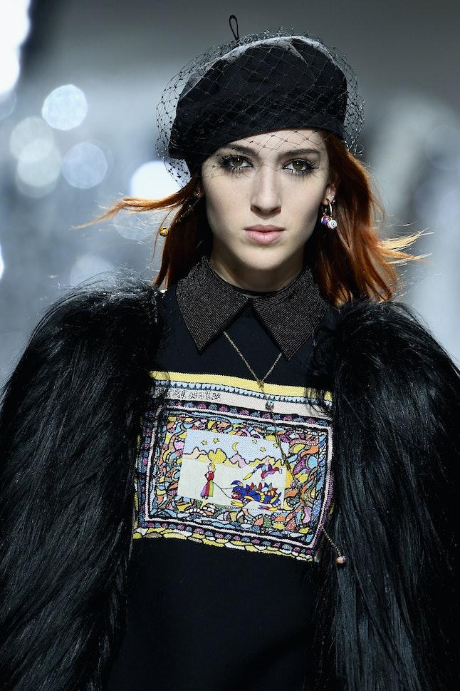 Teddy Quinlivan walks the runway during the Dior show at Paris Fashion Week