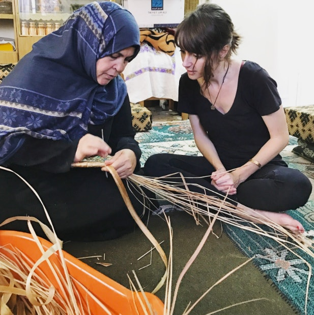 Aliaa, the basket weaver in Um Qais, shows me her craft. She insisted I watch and try it myself, but I couldn't see much of anything. Check out my clenched hands. The gold band on my left arm is my engraved medical bracelet.
