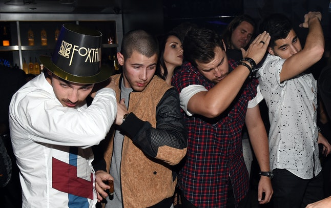 Jonas Brothers and friends dab on New Year's Eve.