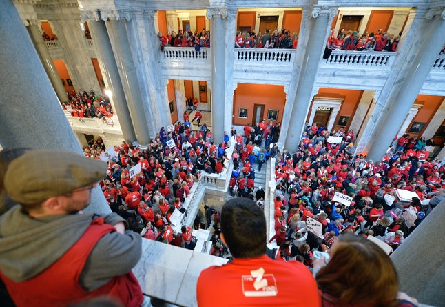 Thousands of teachers from across Kentucky fill the state Capitol to rally for increased funding and to protest last minute changes to their state-funded pension system on Monday in Frankfort, Kentucky.