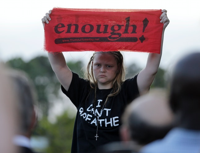 A protester holds up a sign during a protest after Walter Scott's death in Charleston, South Carolina.